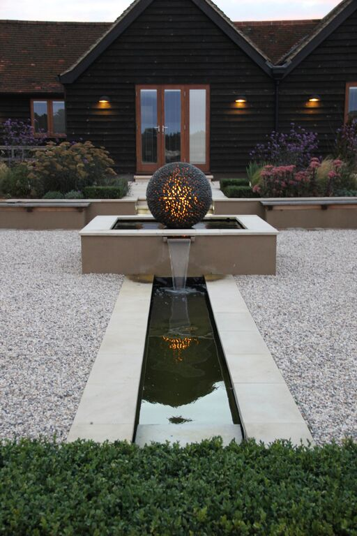 Hertfordshire formal garden with relaxed planting design by Amanda Broughton