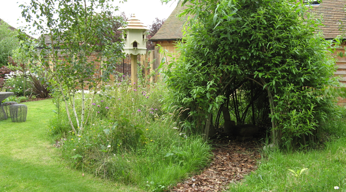 A secret hideaway for the kids! Designed by Amand Broughton Garden Design