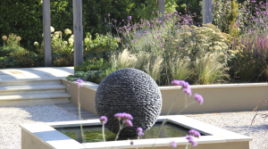 Raised beds, water feature and planting by Amanda Broughton Garden Design