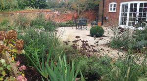 Sloping family garden in Hertfordshire