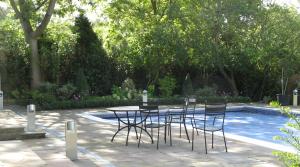 Pool area, borders and garden design by Amanda Broughton