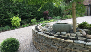 North London garden design with paddle-stone wall by Amanda Broughton