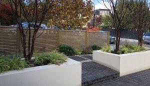 Contemporary slatted fencing in Highgate front garden design