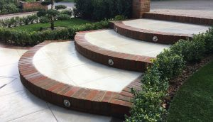 Curved, brick edged, porcelain steps with lighting in Hadley Wood