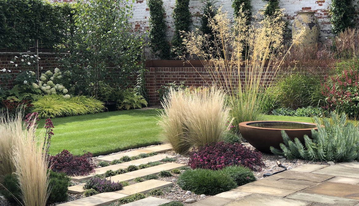 Garden Design with grasses, paving and Urbis water bowl