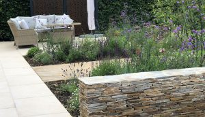 Screen, feature wall and lounge area by garden designer Amanda Broughton