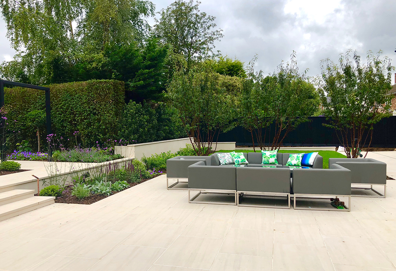 Generous patio in Hertfordshire garden design